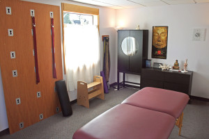 Michael Dennis's spacious office and equipment including the yoga wall, a bodywork bench and massage and bodywork table.